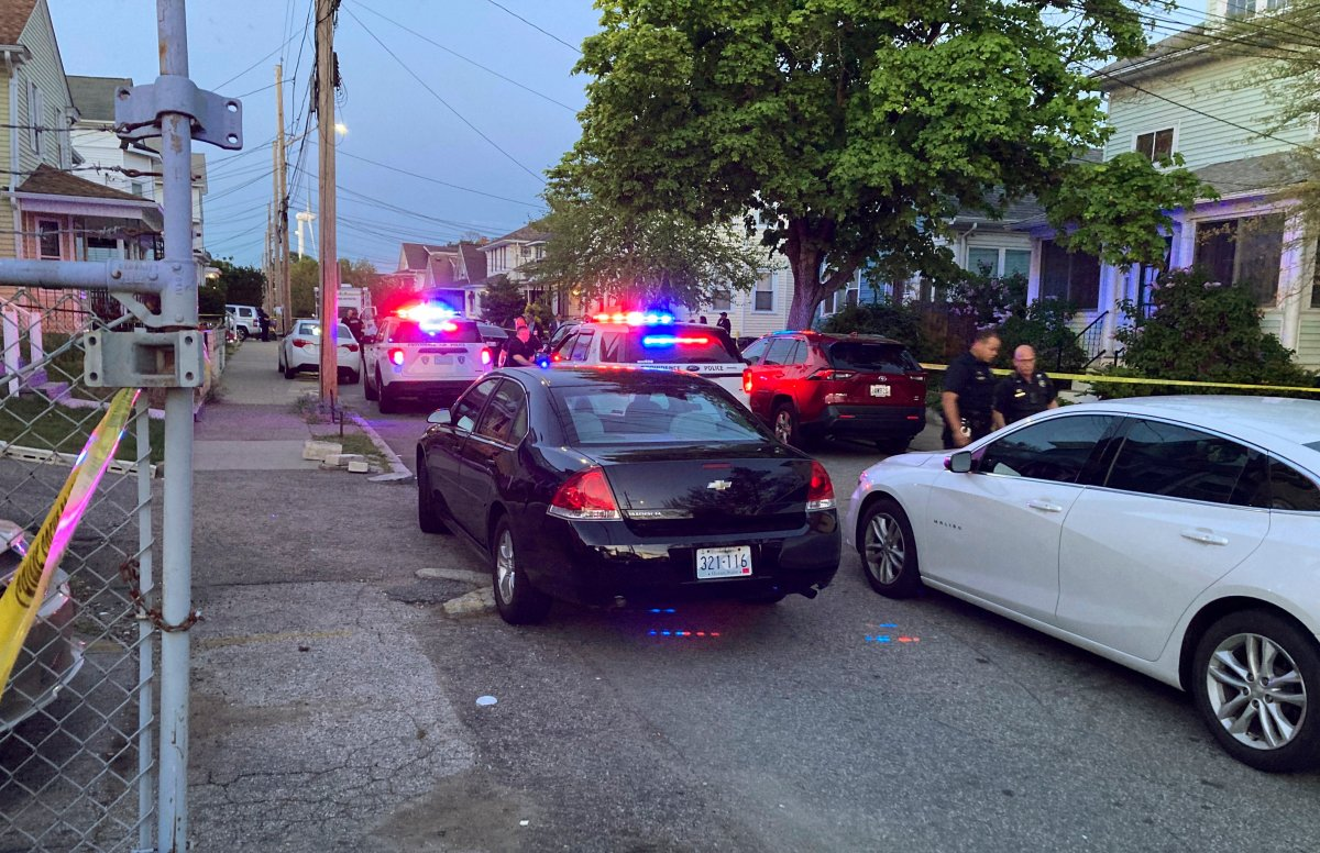 Authorities respond to the scene where multiple people were wounded in a shooting, Thursday, May 13, 2021, in Providence, R.I. (AP Photo/William J. Kole).