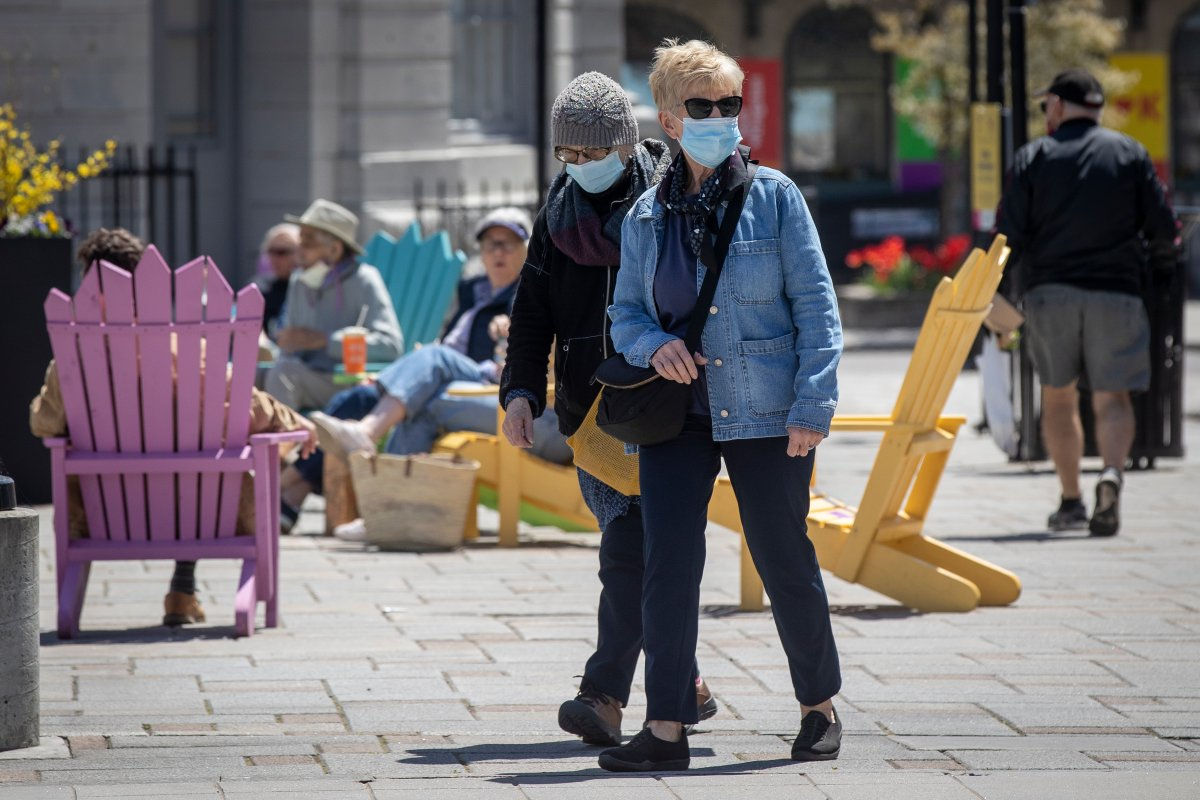 People wear surgical masks to protect them from the COVID-19 virus in Kingston, Ontario on Saturday May 15, 2021.