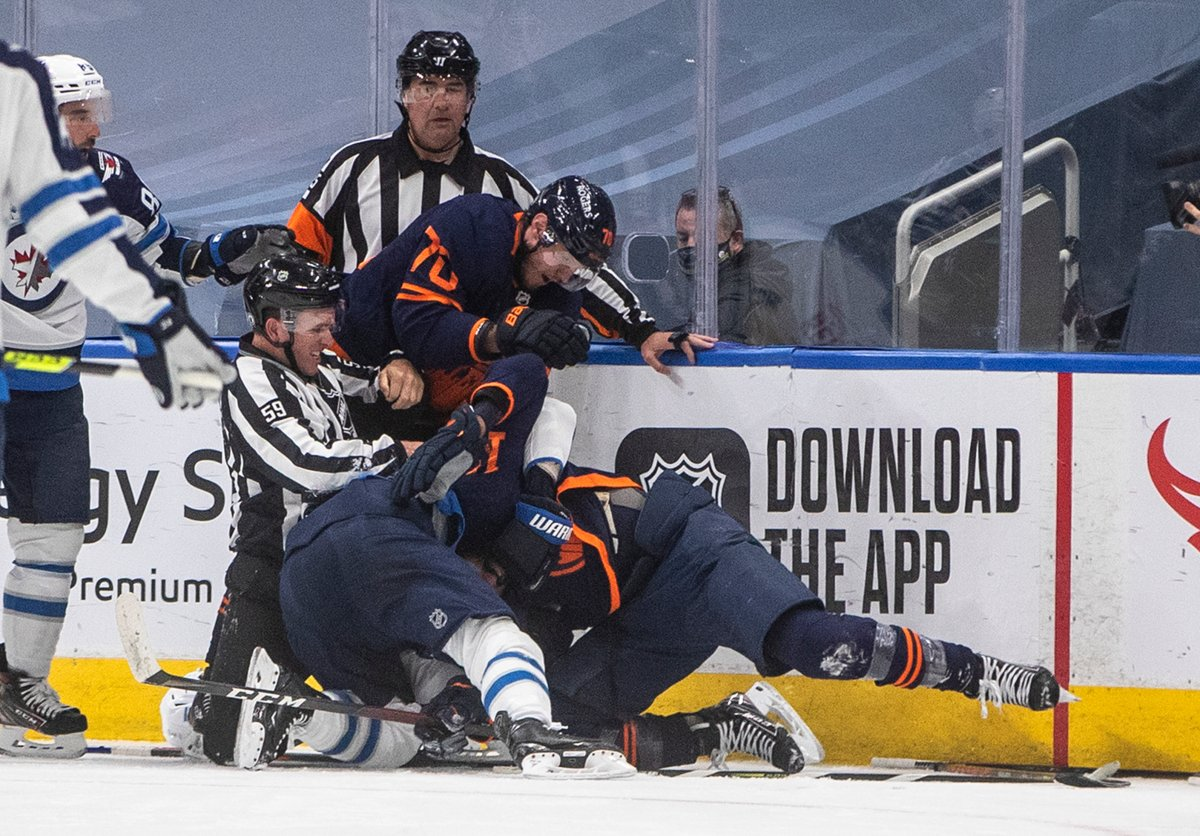 Edmonton Oilers and the Winnipeg Jets players rough it up during second period NHL Stanley Cup playoff action in Edmonton on Friday, May 21, 2021.THE CANADIAN PRESS/Jason Franson.