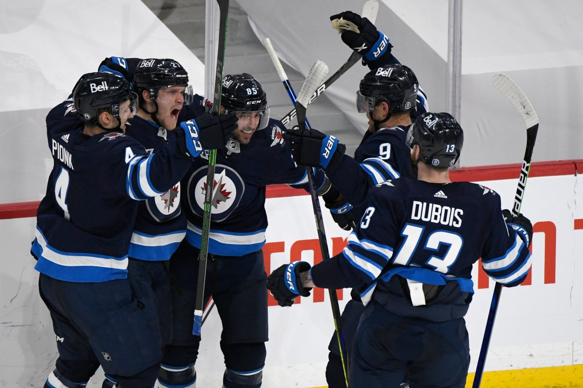 Winnipeg Jets' Nikolaj Ehlers (27) celebrates his goal with teammates during second period NHL Stanley Cup playoff action against the Edmonton Oilers, in Winnipeg on Sunday, May 23, 2021.