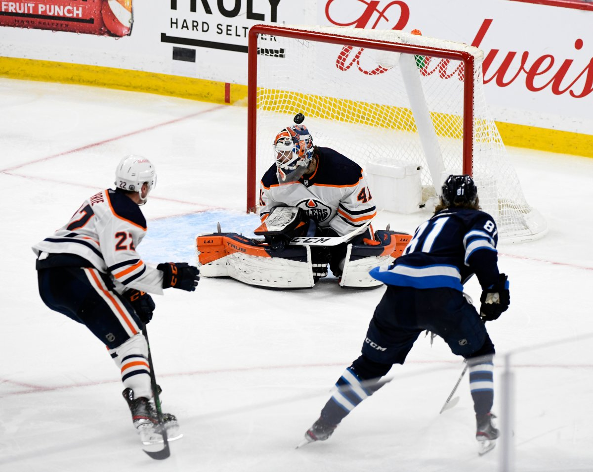 Winnipeg Jets' Kyle Connor (81) scores the game-winning goal on Edmonton Oilers' goaltender Mike Smith (41) during third overtime period NHL Stanley Cup playoff action in Winnipeg on Monday, May 24, 2021.