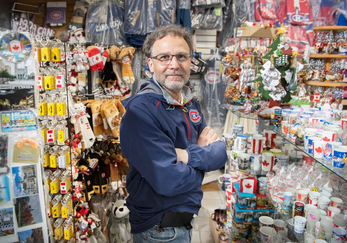 Mohamed Ghodhbane, owner of Noor Souvenirs, poses at his store in Old Montreal, Monday, May 24, 2021.