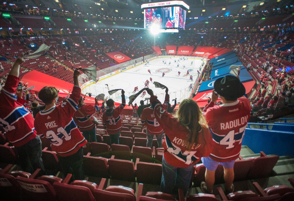 Fans watch the warm-up before Game 6 between the Toronto Maple Leafs and the Montreal Canadiens in NHL playoff hockey action Saturday, May 29, 2021 in Montreal. Quebec's easing of COVID-19 restrictions will allow 2,500 fans to attend the game for the first time in fourteen months.