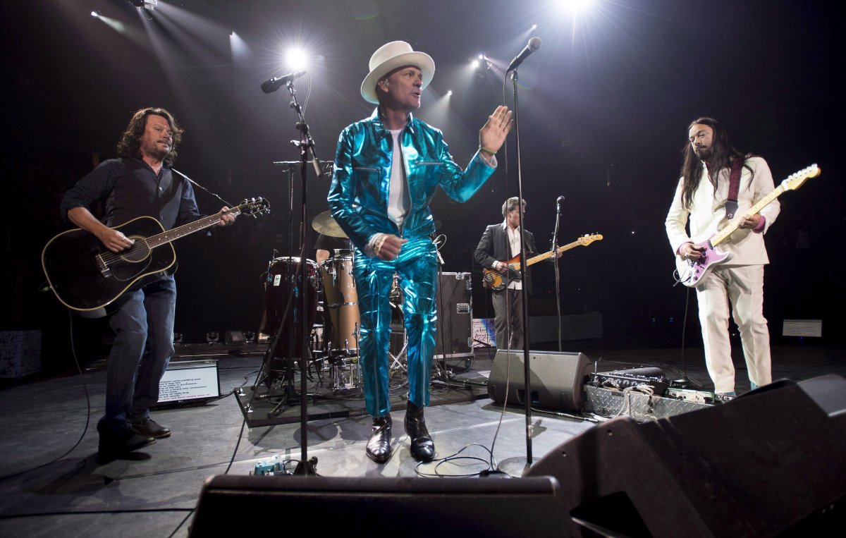 Frontman of the Tragically Hip, Gord Downie, centre, leads the band through a concert in Vancouver, Sunday, July, 24, 2016.