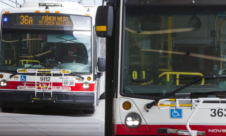 A TTC bus driver wearing a face mask is seen on a bus in this file photo.