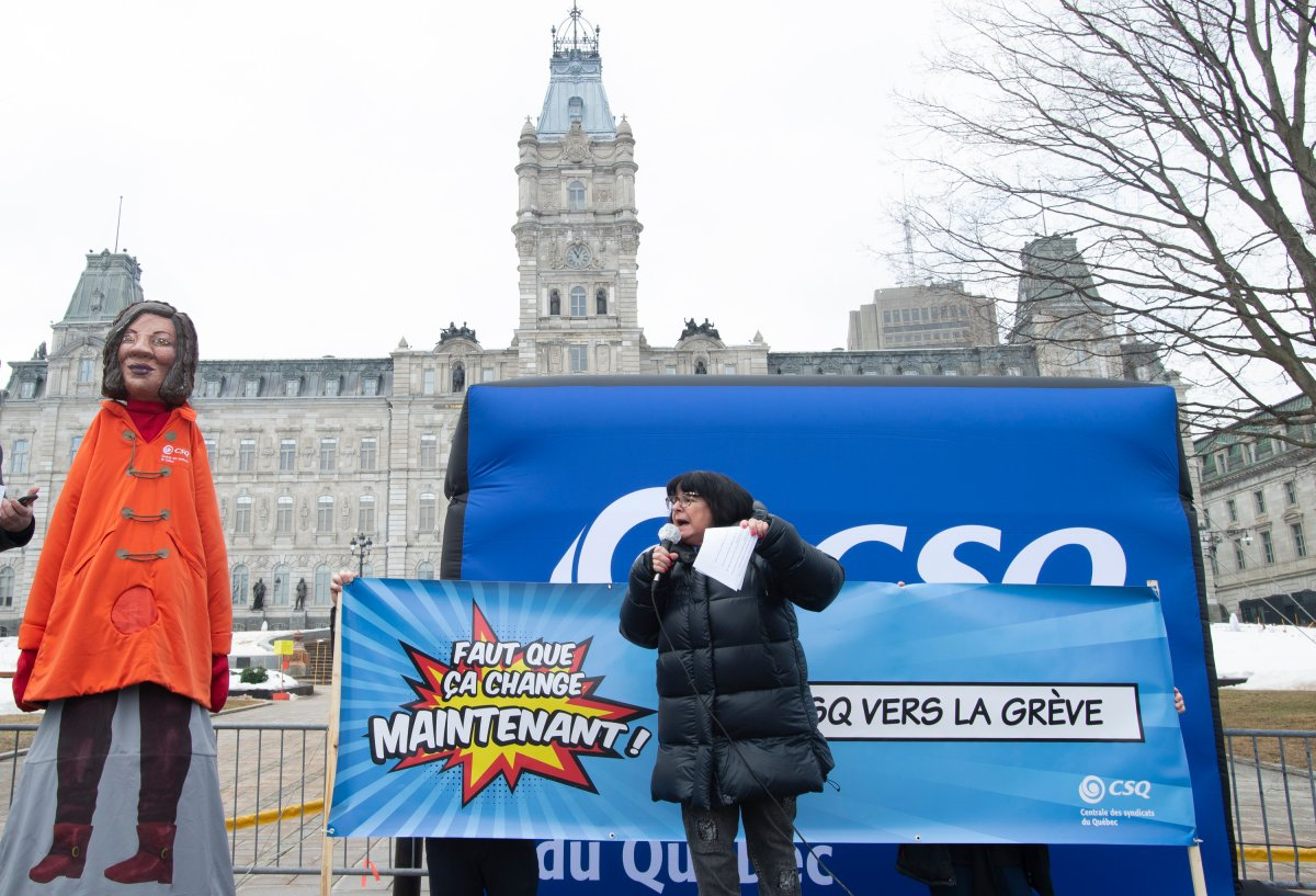 CSQ Teacher's union president Sonia Ethier calls on protestors at a demonstration, Thursday, March 18, 2021 at the legislature in Quebec City.  Ethier announced a strike in some 30 Cegep college for March 30.