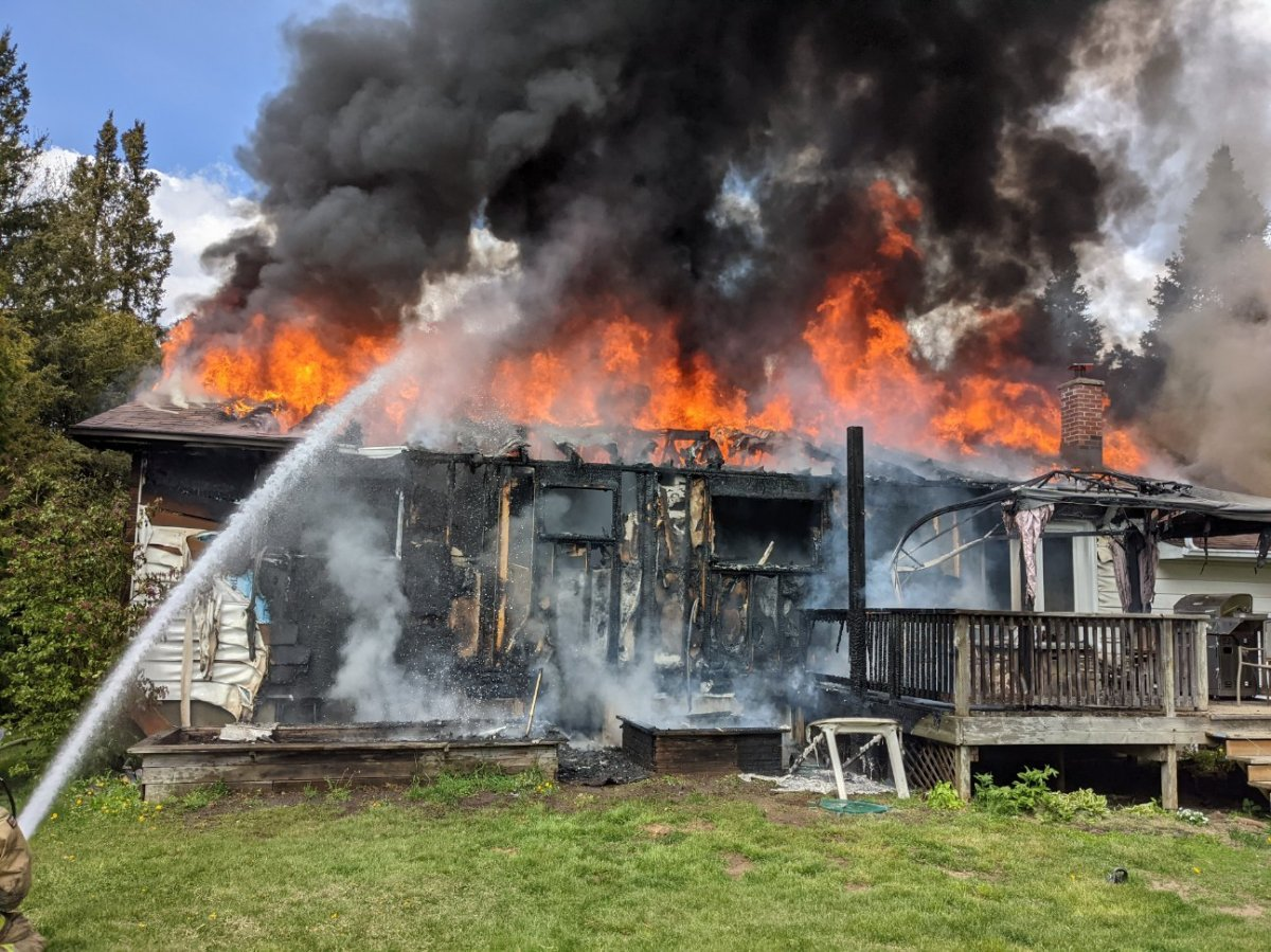 A home on Cedar Acres Drive in Greely was engulfed in flames Monday afternoon.