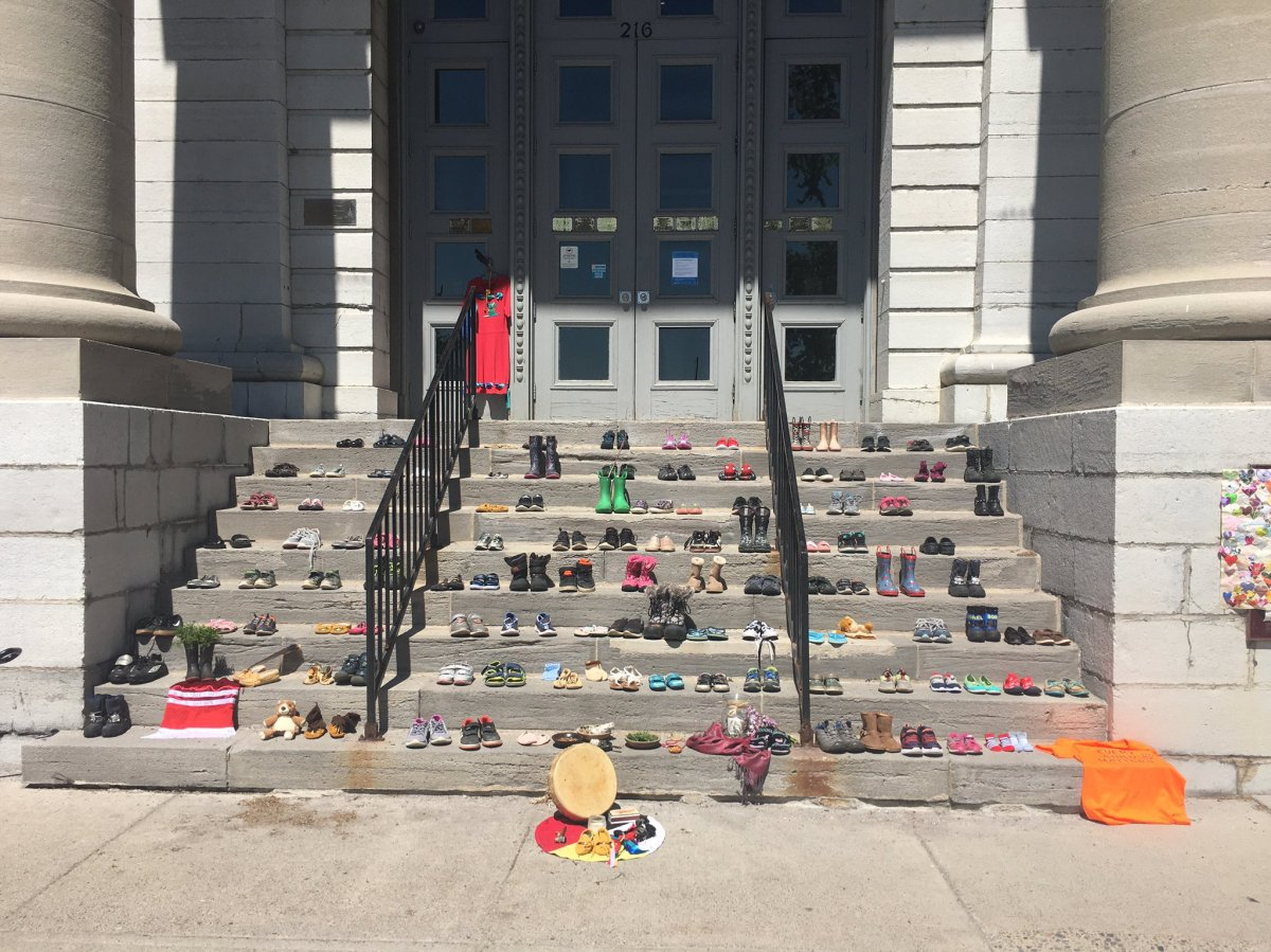 A vigil has been set up on the steps of Kingston's city hall to honour the memory of more than 200 children found buried in a mass grave at a Kamloops, B.C., former residential school.
