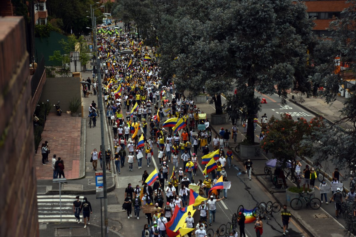 People march to stage a protest against the government in Bogota, Colombia on May 9, 2021.