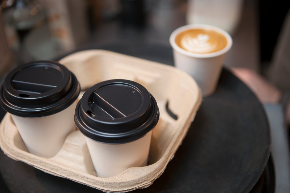 Winnipeg police have laid charges after they say a man punched another man in the face when he refused to buy him a cup of coffee.