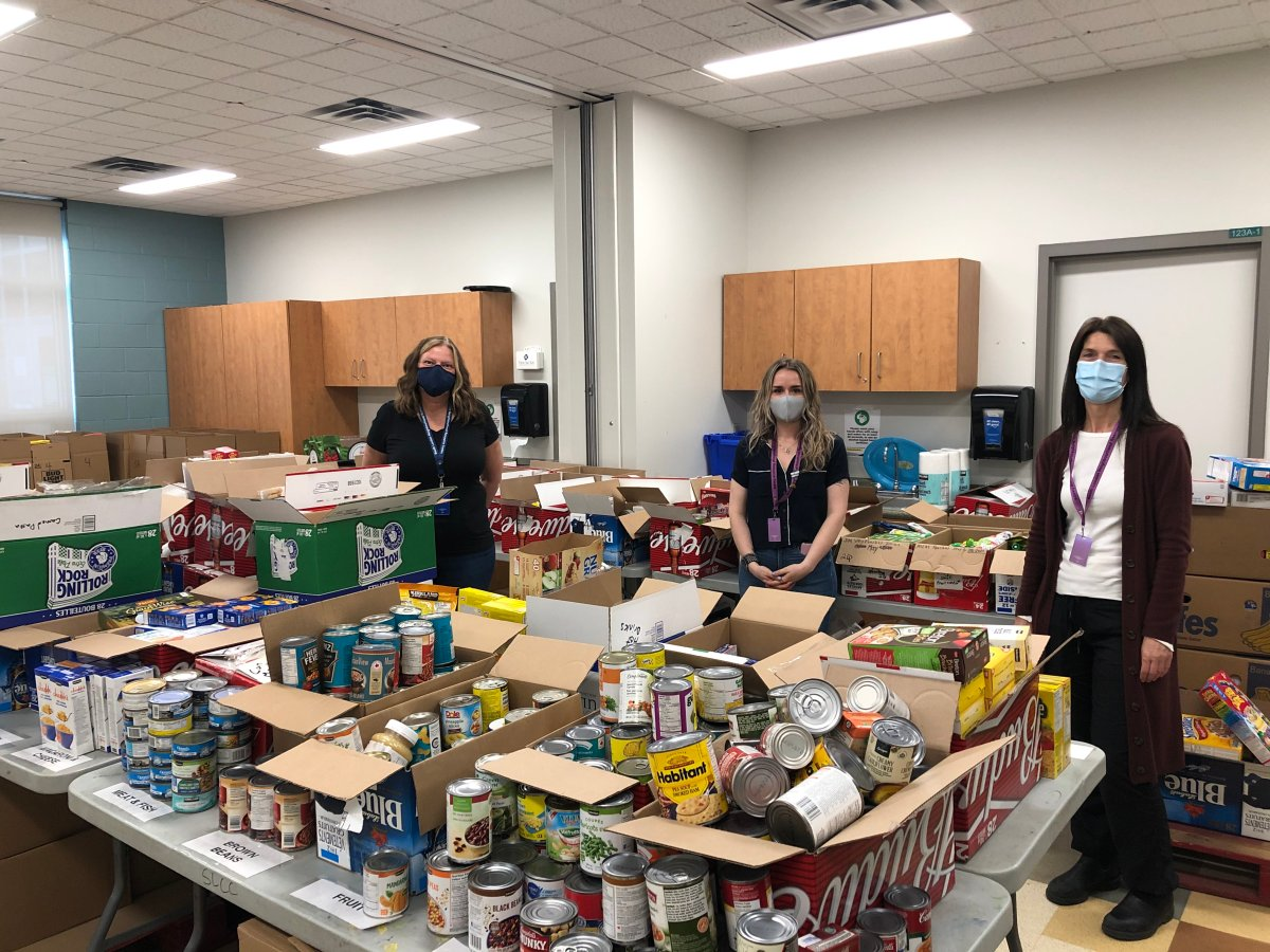 South London Neighbourhood Resource Centre executive director Nancy Needham (left) and fellow staff members Pascale Cantin (centre) and Heather Molen stand alongside a shipment of food reserved for those in need.