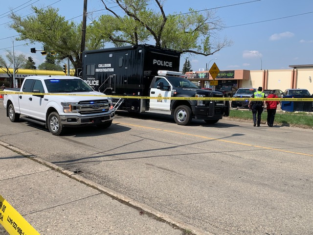 Edmonton police investigate a collision in the area of 126 Street and 129 Avenue on May 21, 2021.