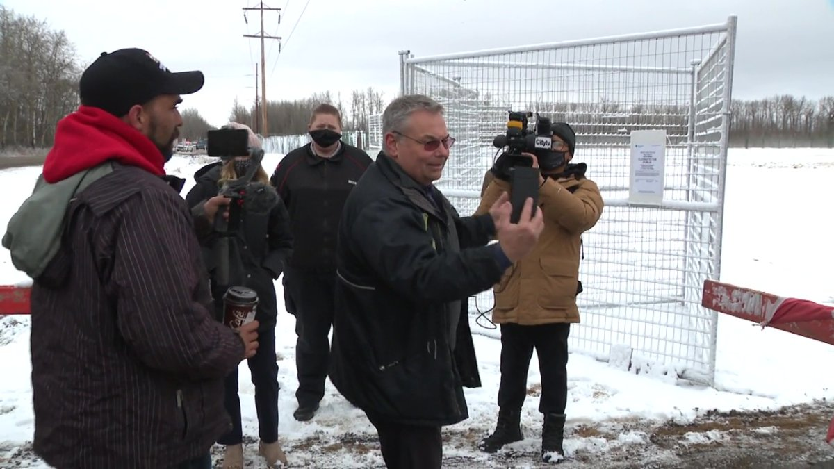 Derek Storie (left) and Kevin Johnston (right) attending a rally outside GraceLife Church in Parkland County, near Edmonton, on April 11, 2021.
