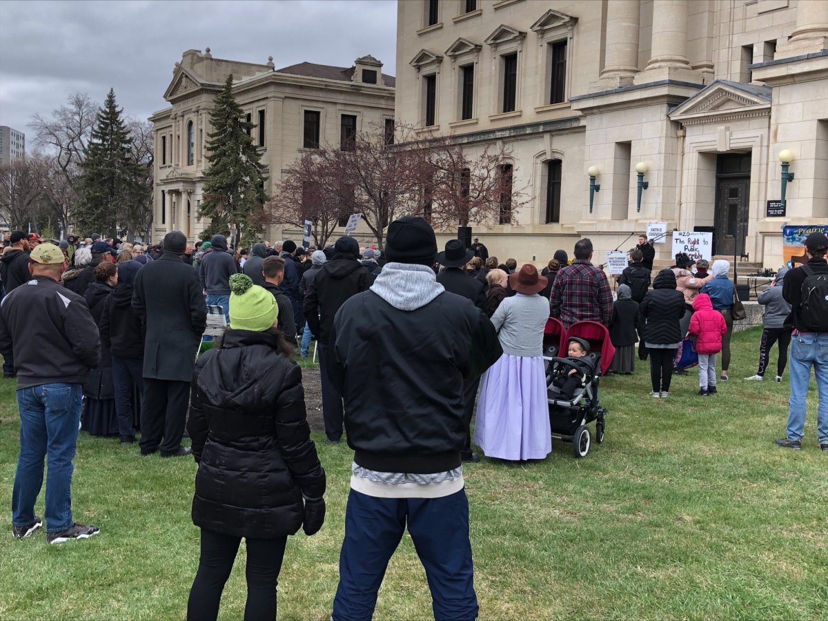 Manitoba Justice officials say four tickets were handed out at an anti-restrictions protest held outside the law courts in Winnipeg Monday.
