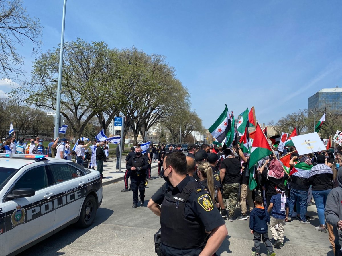 Pro-Palestinian and pro-Israel demonstrators met in front of Manitoba's legislative building Saturday afternoon.