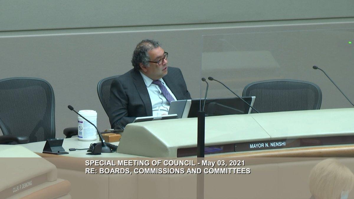 Calgary Mayor Naheed Nenshi sits in council chambers on May 3, 2021.