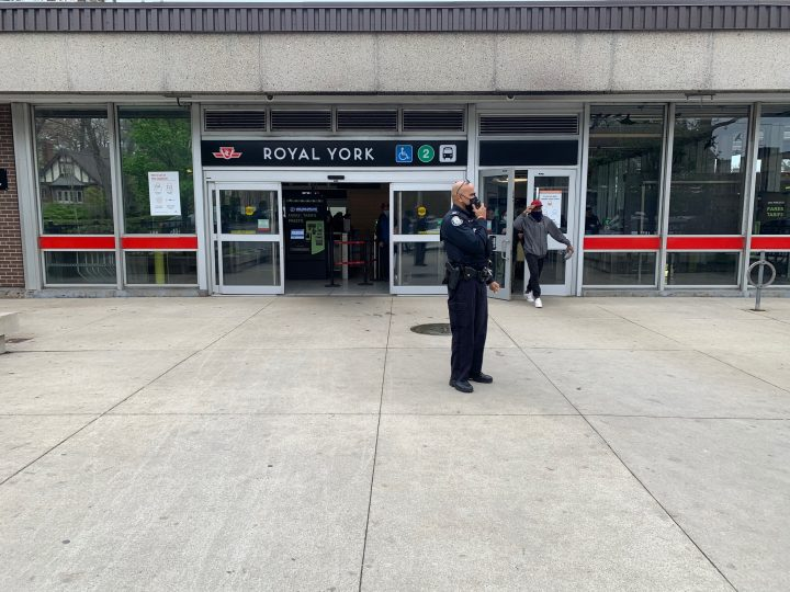 A police officer is seen outside of Royal York Station after a stabbing there on Tuesday.