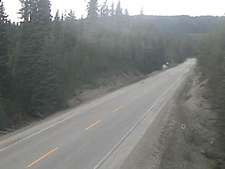 Road conditions along Paulson Summit on Wednesday morning, May 19, 2021. Environment Canada is calling for periods of snow for elevations above 1,400 metres, starting Wednesday evening through to midday Thursday.