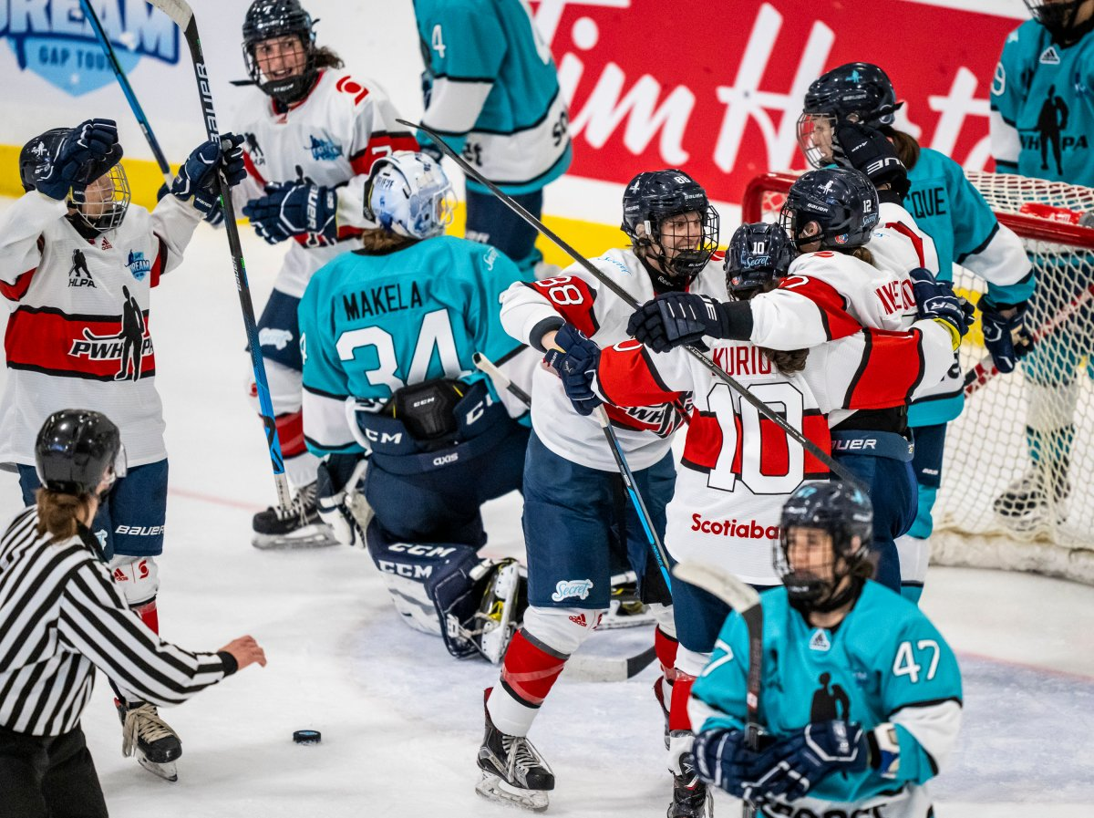 Iya Gavrilova (center) and Team Scotiabank celebrate during the Professional Women's Hockey Players  Association (PWHPA) Secret Dream Gap Tour at the Seven Chiefs Arena on the  Tsuut'ina Nation on May 26, 2021. (Photo: Dave Holland/PWHPA).
