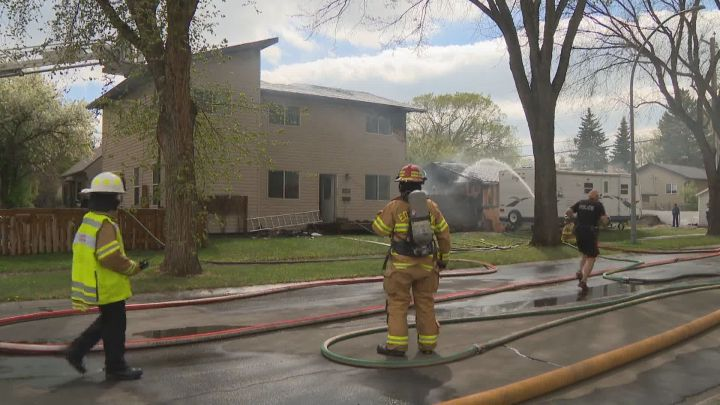 Firefighters at the scene of a fire in Edmonton's Parkdale neighbourhood on Wednesday, May 26, 2021.