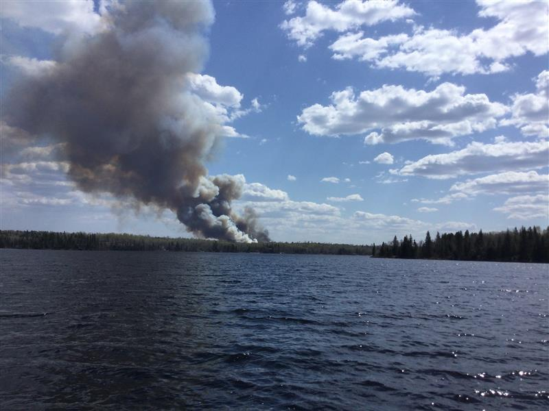 Smoke can be seen from a fire in the Whiteshell near Falcon Lake.
