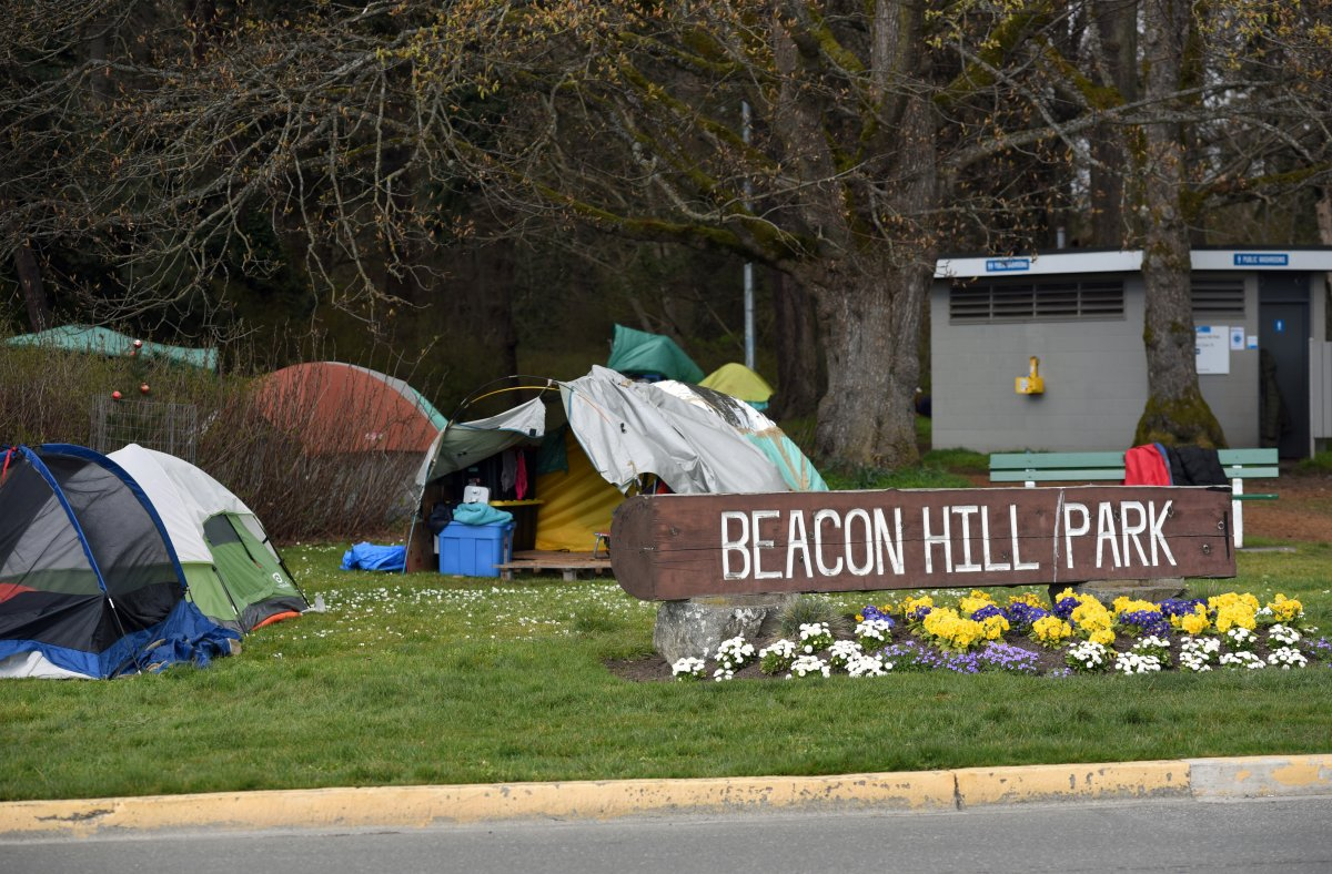 Tents belonging to homeless campers are pitched on the grass in Beacon Hill Park in Victoria, British Columbia on Vancouver Island on March 22, 2021.