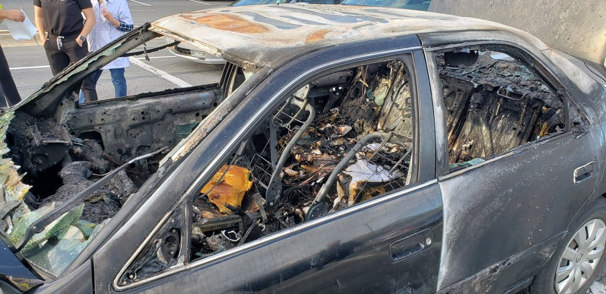 A sedan is shown in Rockville, Md., after a cigarette ignited some hand sanitizer and set the vehicle on fire on May 13, 2021.