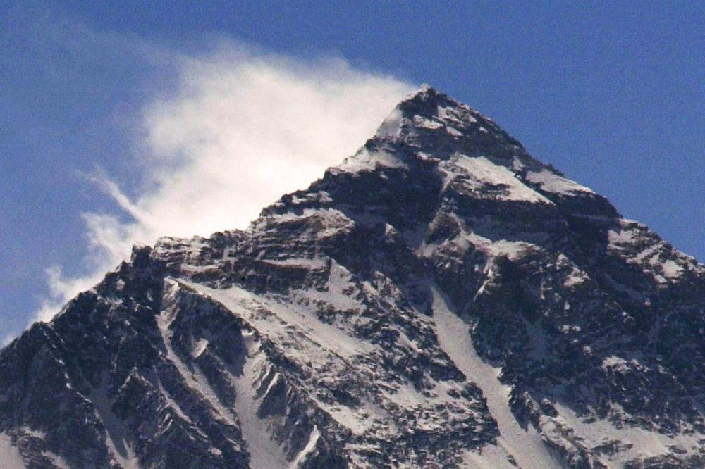 Clouds move from Nepal around Mount Everest Himalayas in Tibet.
