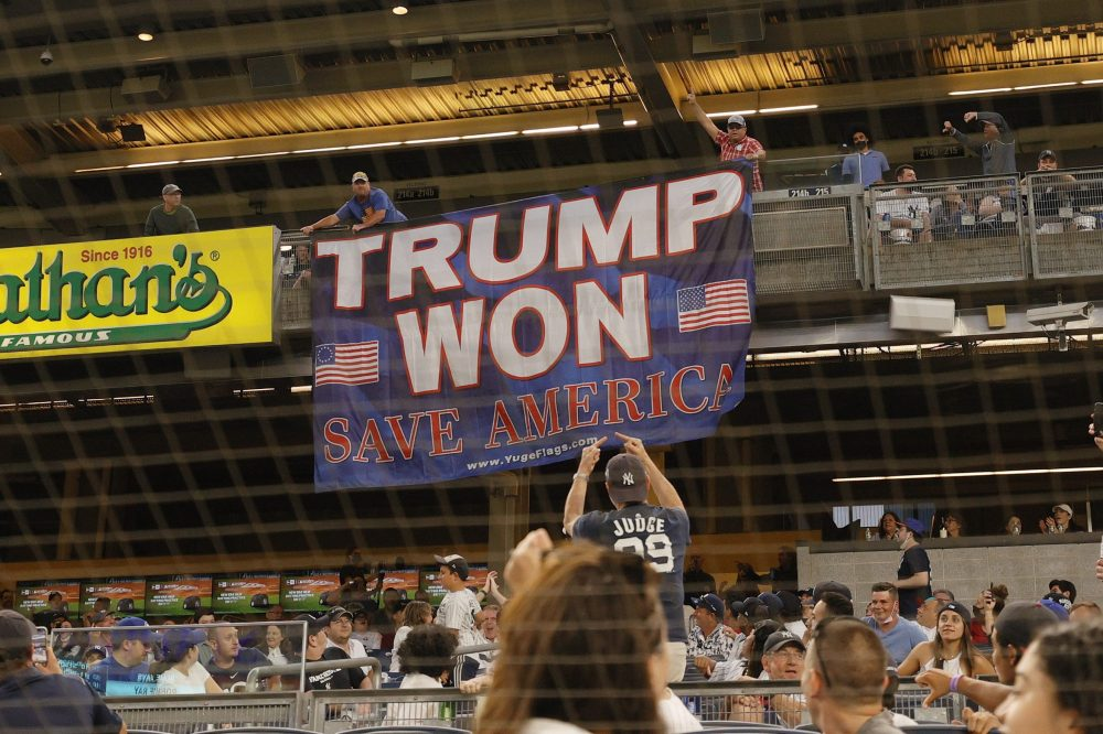 Fans unroll a banner in support of former U.S. President Donald Trump during the fourth inning of Game Two of a doubleheader between the Toronto Blue Jays and the New York Yankees at Yankee Stadium on May 27, 2021 in the Bronx borough of New York City.