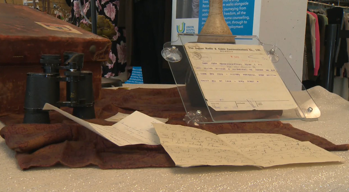 A suitcase, letters, and a cable that appears to have been sent on VE Day displayed at the Union Gospel Mission in Vancouver.