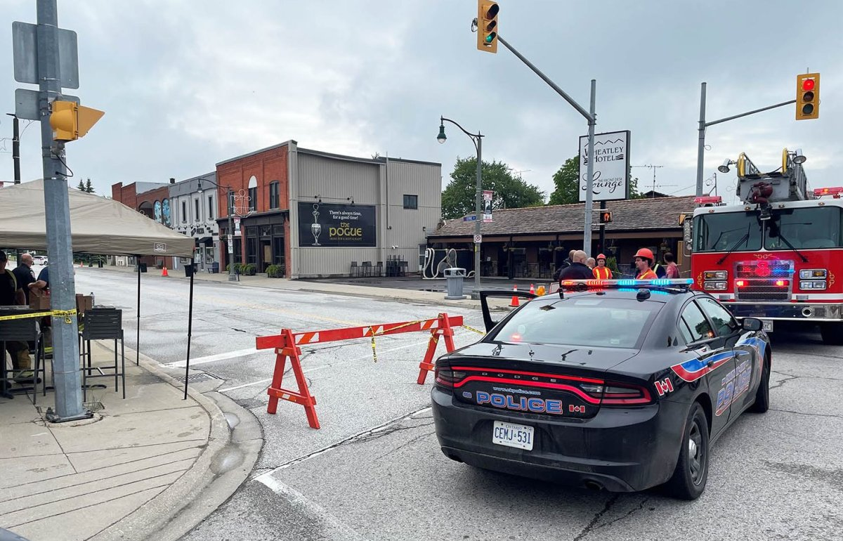 Officials stationed in the core of Wheatley in June following detection of hydrogen sulphide. The red-bricked building and the white building next door were destroyed in Thursday's explosion.