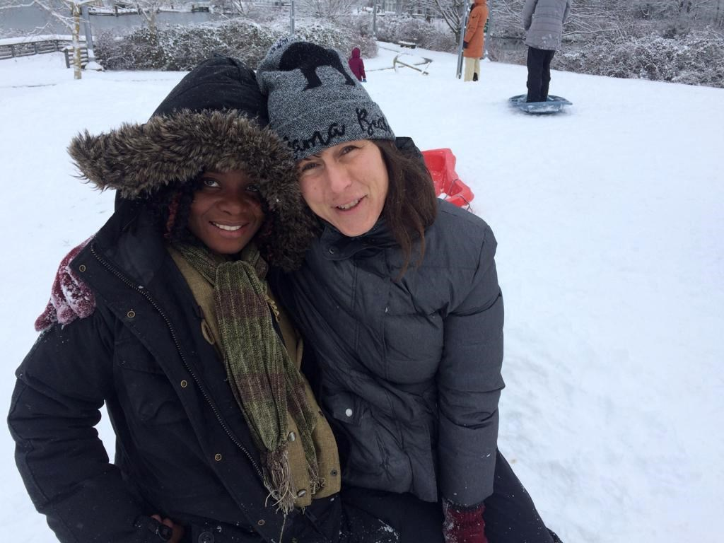 Atosha Ngage (left) and Karina Reid went on a trip to see snow as shown in this undated handout image. Ngage, a refugee from the Democratic Republic of Congo, just arrived in Canada and it's her first time experiencing winter.