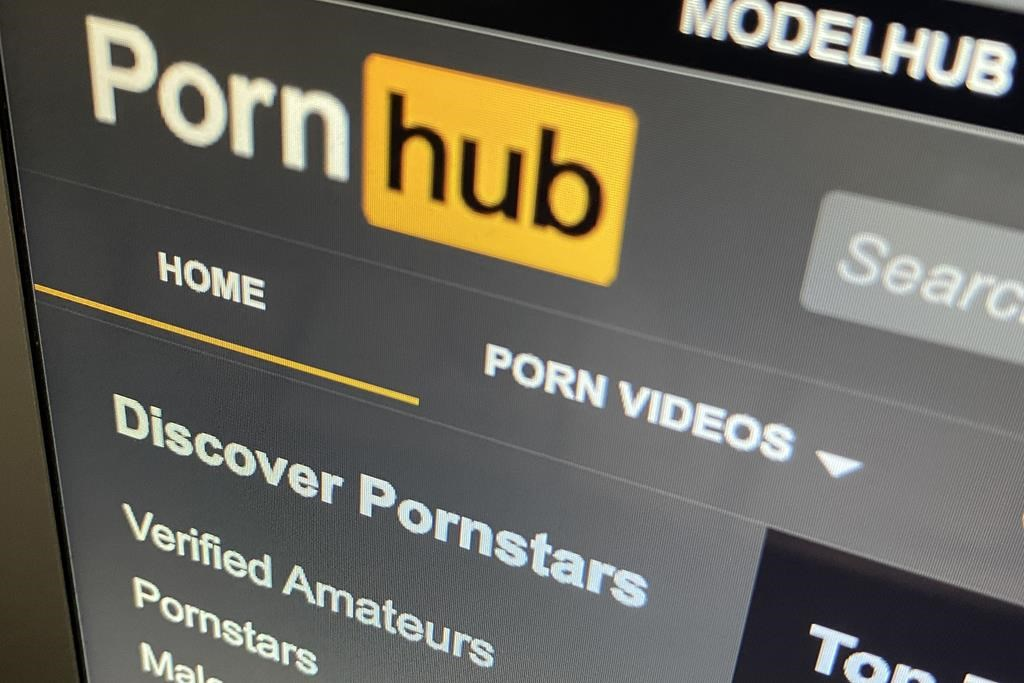The Pornhub website is shown on a computer screen in Toronto on December 16, 2020. Members of the House of Commons ethics committee that study the protection and privacy of Canadians on platforms such as Pornhub have released recommendations for the federal government today.