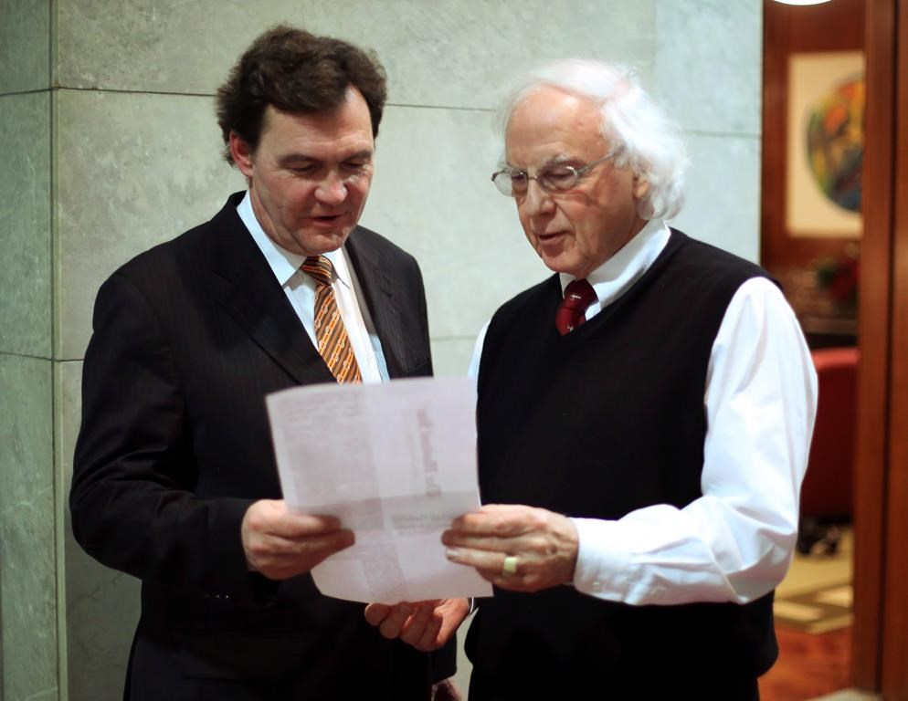 Federal Supreme Court Justice, Richard Wagner (left) confers with his colleague Supreme Court Justice Morris Fish in Ottawa, Monday December 10 2012. Fish is calling for urgent reforms to Canada's military justice system to prevent victims of misconduct, sexual and otherwise, from continuing to suffer. THE CANADIAN PRESS/Fred Chartrand.
