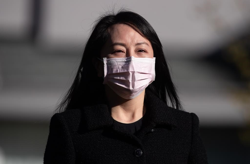 Meng Wanzhou, chief financial officer of Huawei, leaves her home to attend a hearing at B.C. Supreme Court, in Vancouver, on Monday, March 29, 2021. The Supreme Court of British Columbia has dismissed an application for a publication ban from Huawei chief financial officer Meng Wanzhou on new evidence that her legal team wants to introduce in her fight against extradition to the United States. THE CANADIAN PRESS/Darryl Dyck.