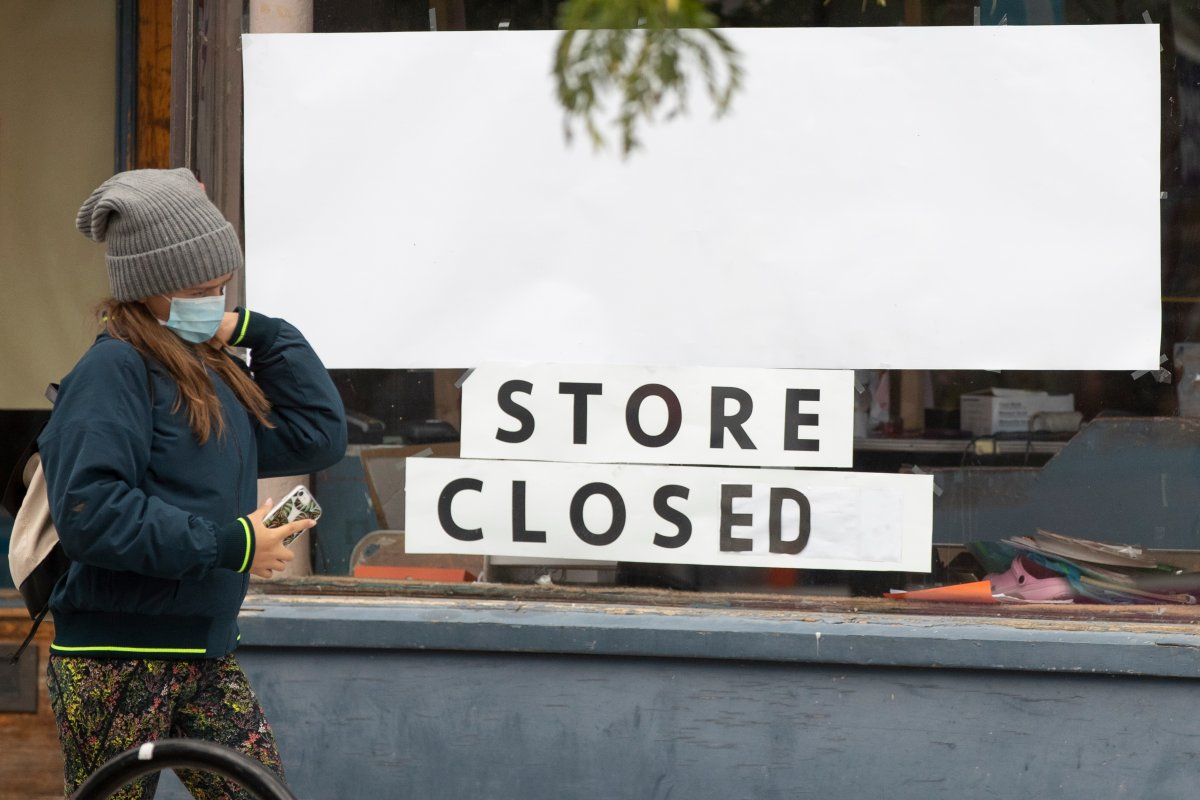 A person wears a mask outside a closed store in Kingston, Ont., on Oct. 9, 2020 as the COVID-19 pandemic continues.