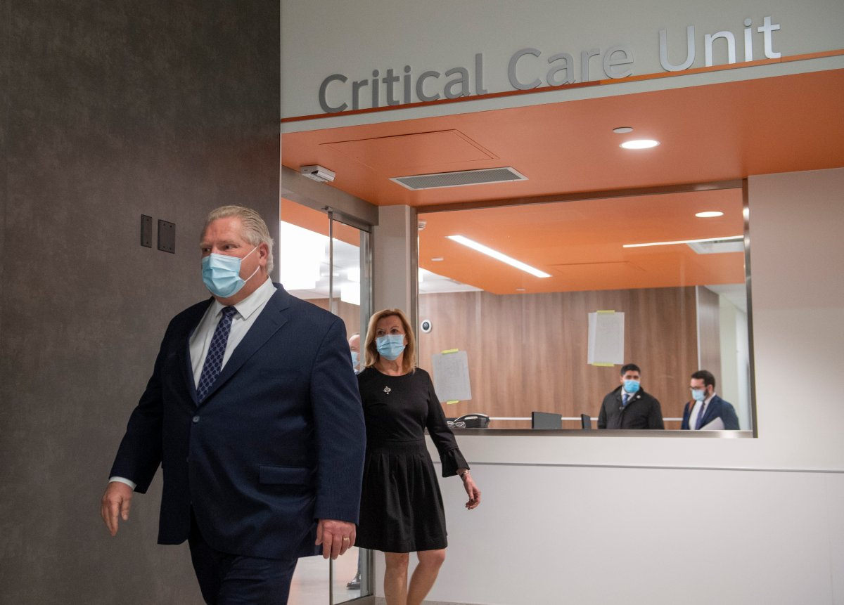 Ontario Premier Doug Ford and Health Minister Christine Elliot walk out after being given a tour of a digital Intensive Care Unit room at Cortellucci Vaughan Hospital in Vaughan, Ontario on Monday, January 18, 2021.