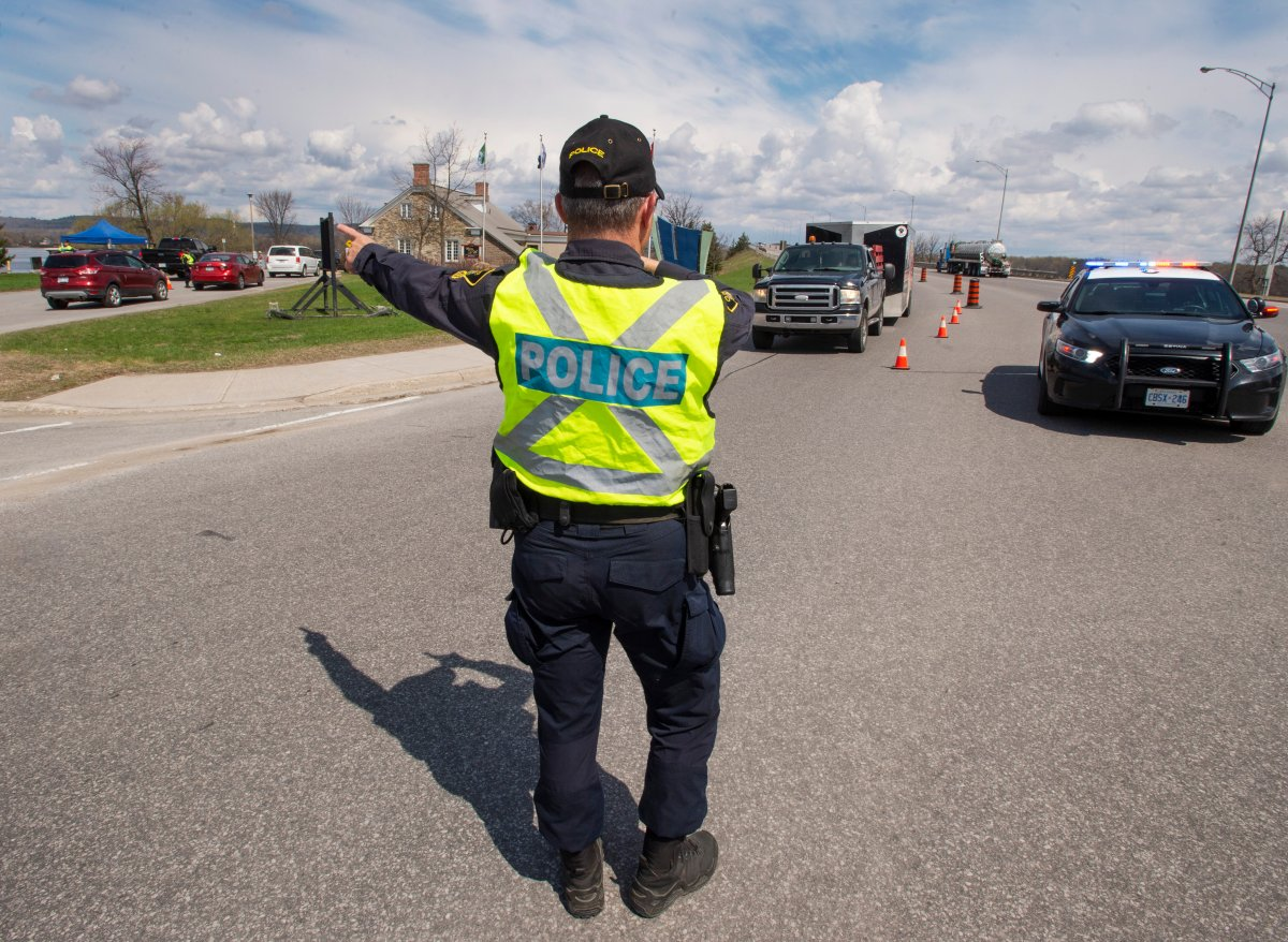 Ontario Provincial Police check travellers entering Ontario from Quebec  in Hawkesbury, Ont.