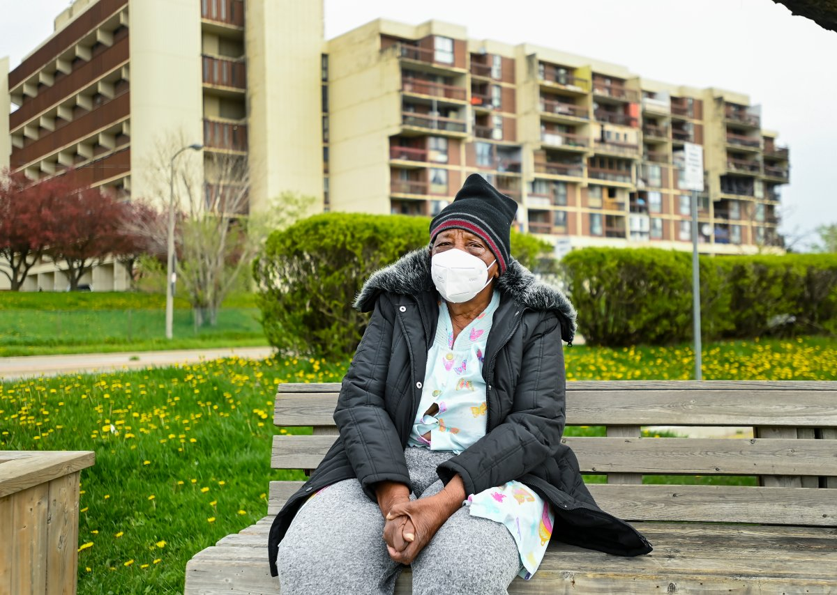 An elderly woman rests on a bench in a neighbourhood that Ontario has designated a postal code hotspot during the COVID-19 pandemic in Toronto on Monday, May 3, 2021.