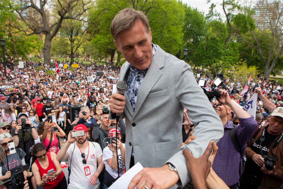 Maxime Bernier, Leader of the People's Party of Canada prepares to speak to the crowd as protesters demonstrate against measures taken by government and public health authorities to curb the spread of COVID-19, in Toronto, Saturday, May 15, 2021. Bernier was arrested in Manitoba Friday, June 11, 2021 for violating public health orders.