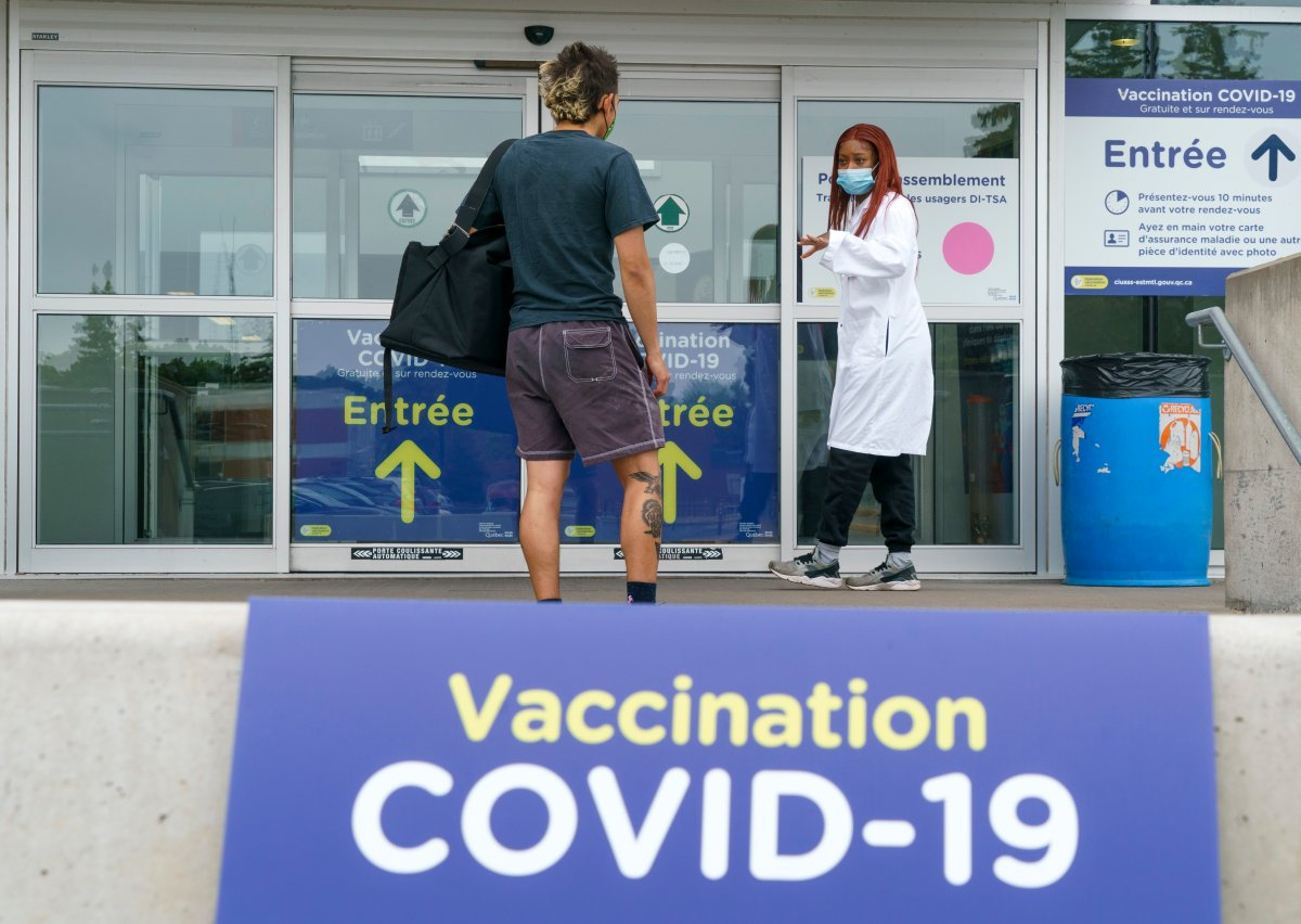 A man is welcomed at a COVID-19 vaccination clinic in Montreal, on Tuesday, June 1, 2021.