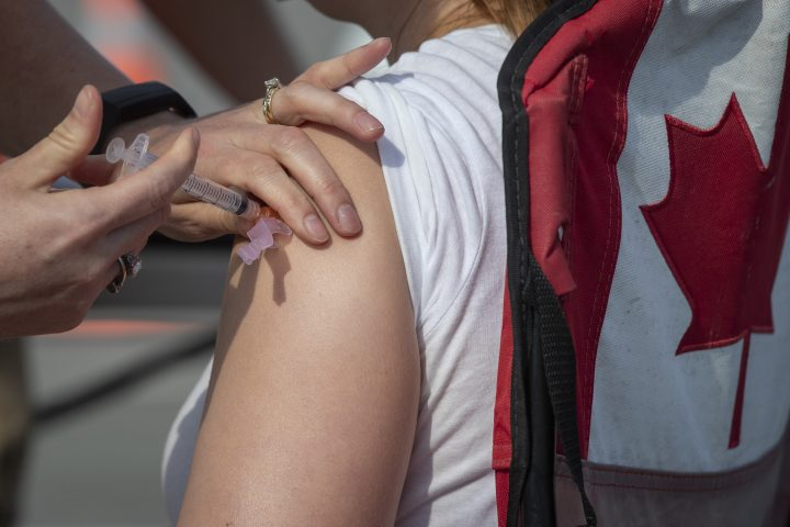 A person receives a COVID-19 vaccine during a drive-thru vaccine clinic in Kingston, Ontario on Friday June 4, 2021.