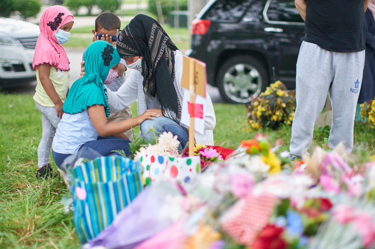 Kira Stephani of Oshawa, Ont., talks with her daughter Aisha Sayyed on Tuesday, June 8, 2021 at the scene of Sunday's hate-motivated vehicle attack in London, Ont., which left four members of a Muslim family dead and sent their youngest boy to hospital.