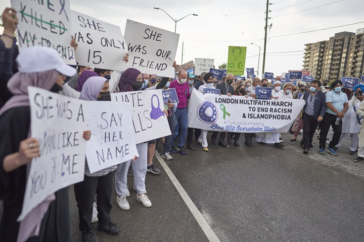 Local faith leaders stand at the front of a march calling to end Islamophobia in London, Ont., on June 11.