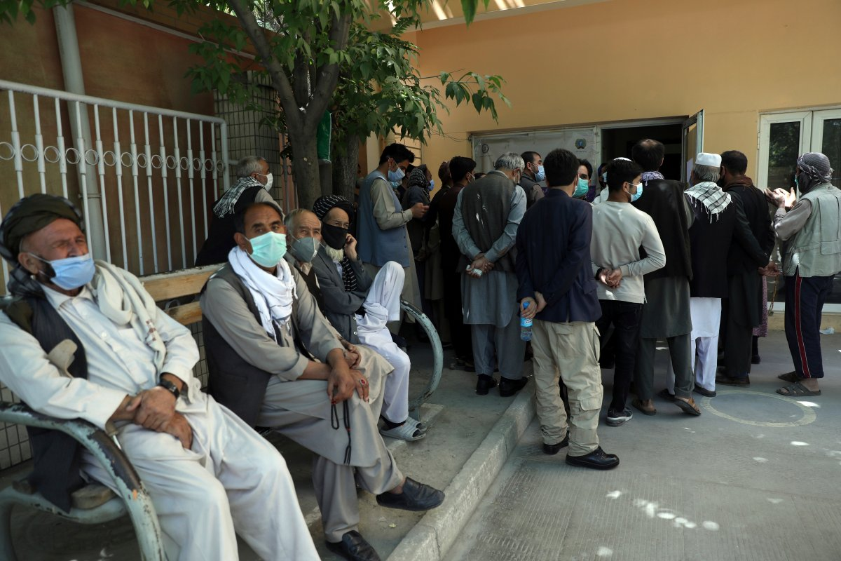 Residents wearing face masks to help curb the spread of the coronavirus line up to receive the Sinopharm COVID-19 vaccine at a vaccination center in Kabul, Afghanistan, Wednesday, June 16, 2021.