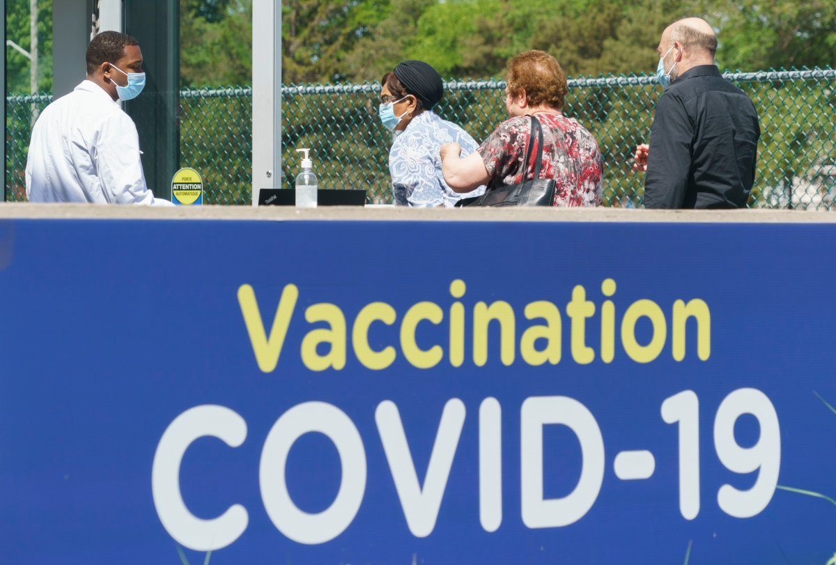 People line up at a COVID-19 vaccination clinic in Montreal, on Wednesday, June 16, 2021.