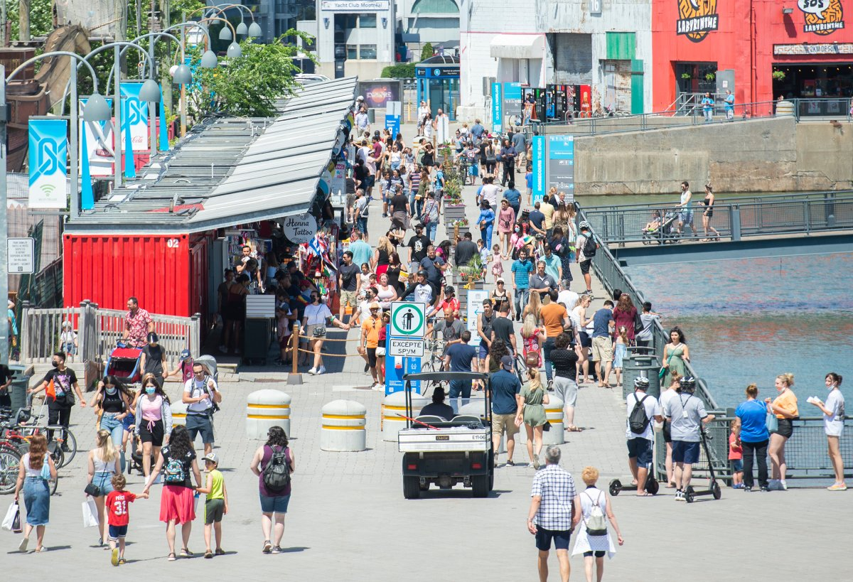 People walk in the Old Port in Montreal, Saturday, June 19, 2021, as the COVID-19 pandemic continues in Canada and around the world.