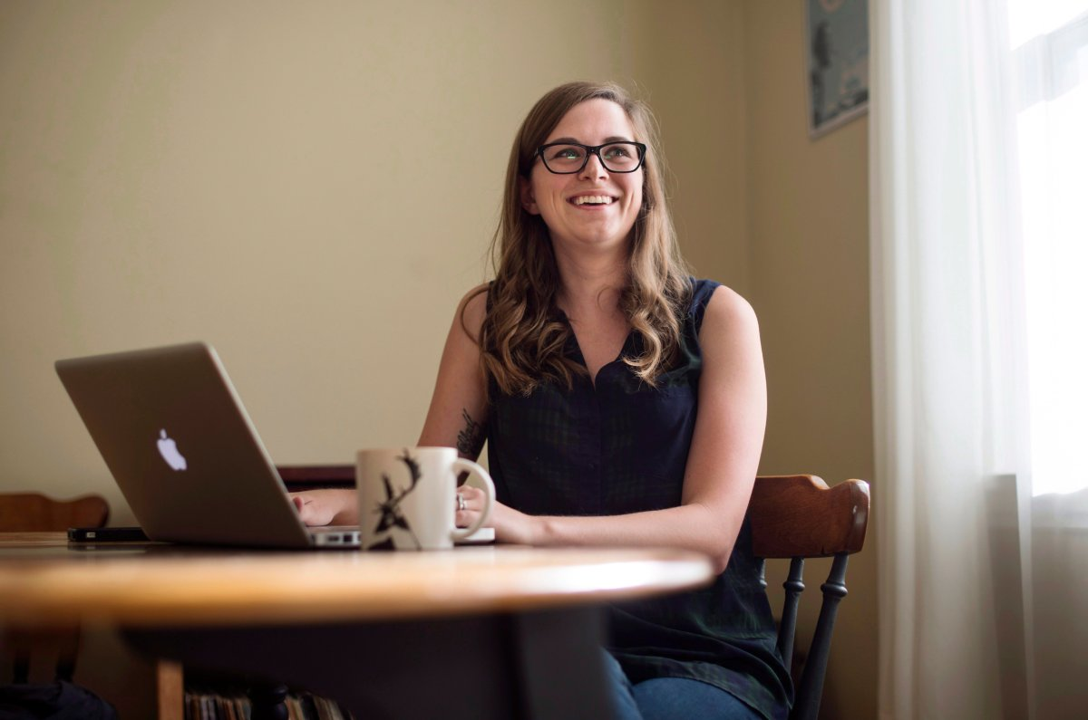 Jordann Brown, a marketing manager who works remotely from home, poses in Halifax on Wednesday, August 10, 2016.