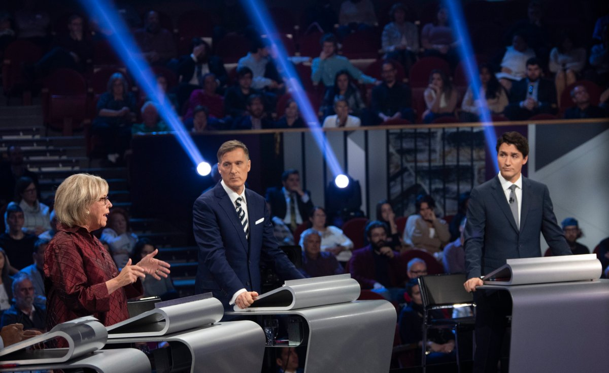 Green Party leader Elizabeth May, left to right, People's Party of Canada leader Maxime Bernier, and Liberal leader Justin Trudeau takes part in the the Federal leaders French language debate in Gatineau, Que. on Thursday, October 10, 2019.