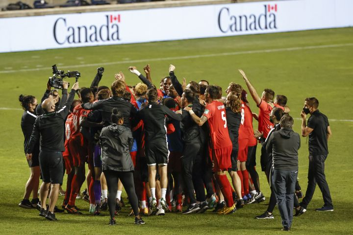 Canada celebrates a 3-0 win over Haiti in a World Cup qualifying soccer match, Tuesday, June 15, 2021, in Bridgeview, Ill.